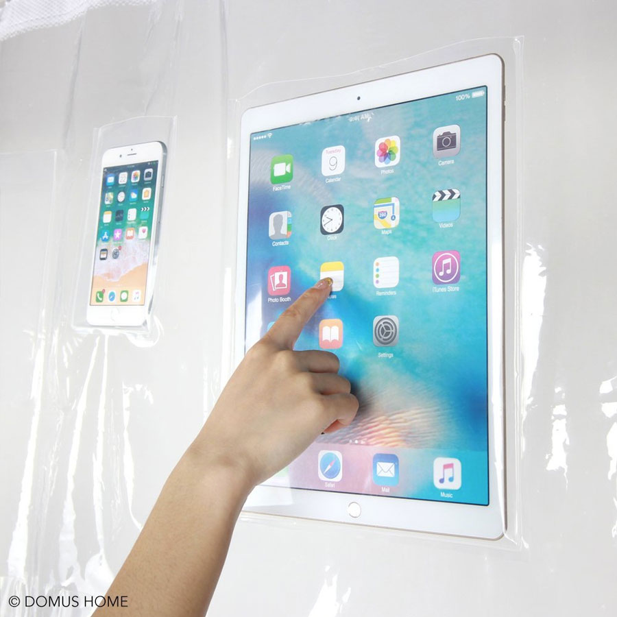Clear Shower Curtain with Phone & Tablet Pockets | DudeIWantThat.com