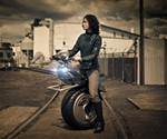 Woman on RYNO One Wheel Motorcycle