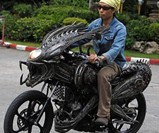 Man Riding Alien Motorcycle