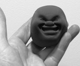 Smooshy Face Stress Ball Black Smile