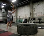 Guy in Pink Converse Swinging Sledgehammer