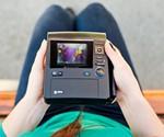 Polaroid Z340 Instant Camera in Girl's Lap