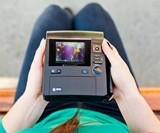 Polaroid Z340 Instant Camera in Girl's Lap