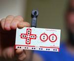 Man Holding MaKey MaKey Invention Kit