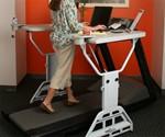 Woman Using Treadmill Desk