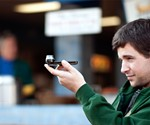 Guy Holding The Dot iPhone Panorama Lens