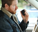 Man Using CB Radio iPhone Handset