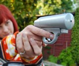 Woman Firing Mace Pepper Spray Gun