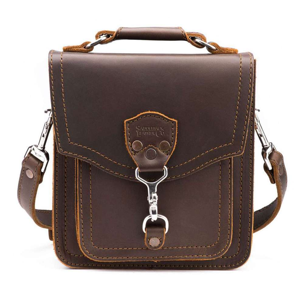 Saddleback Leather Co. thin briefcase, large size, made of full-grain leather, dark coffee bean brown color. Spacious interior with partition to make two large pockets, one smaller interior pocket that can be used for small notebook, one interior pen pocket, one exterior slip pocket on the back,interior key clip with detachable key ring.