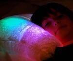 Kid Sleeping on Moonlight Pillow