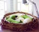 Boy Playing in Bird's Nest Bed