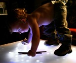 Toddler on LED Interactive Table