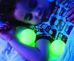 Kid Sleeping with Portable Ball Nightlight