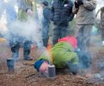 Man Igniting Backcountry Boiler