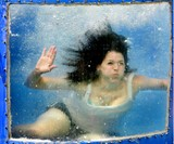 Girl in View Window of Backyard Dunk Tank