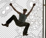 Man Climbing Lace Fence