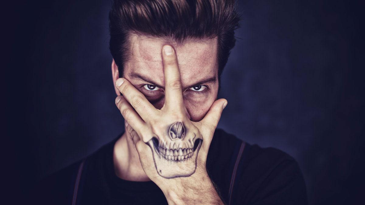 d1c1dcf2e65dd Skull Hand Tattoo | DudeIWantThat.com
