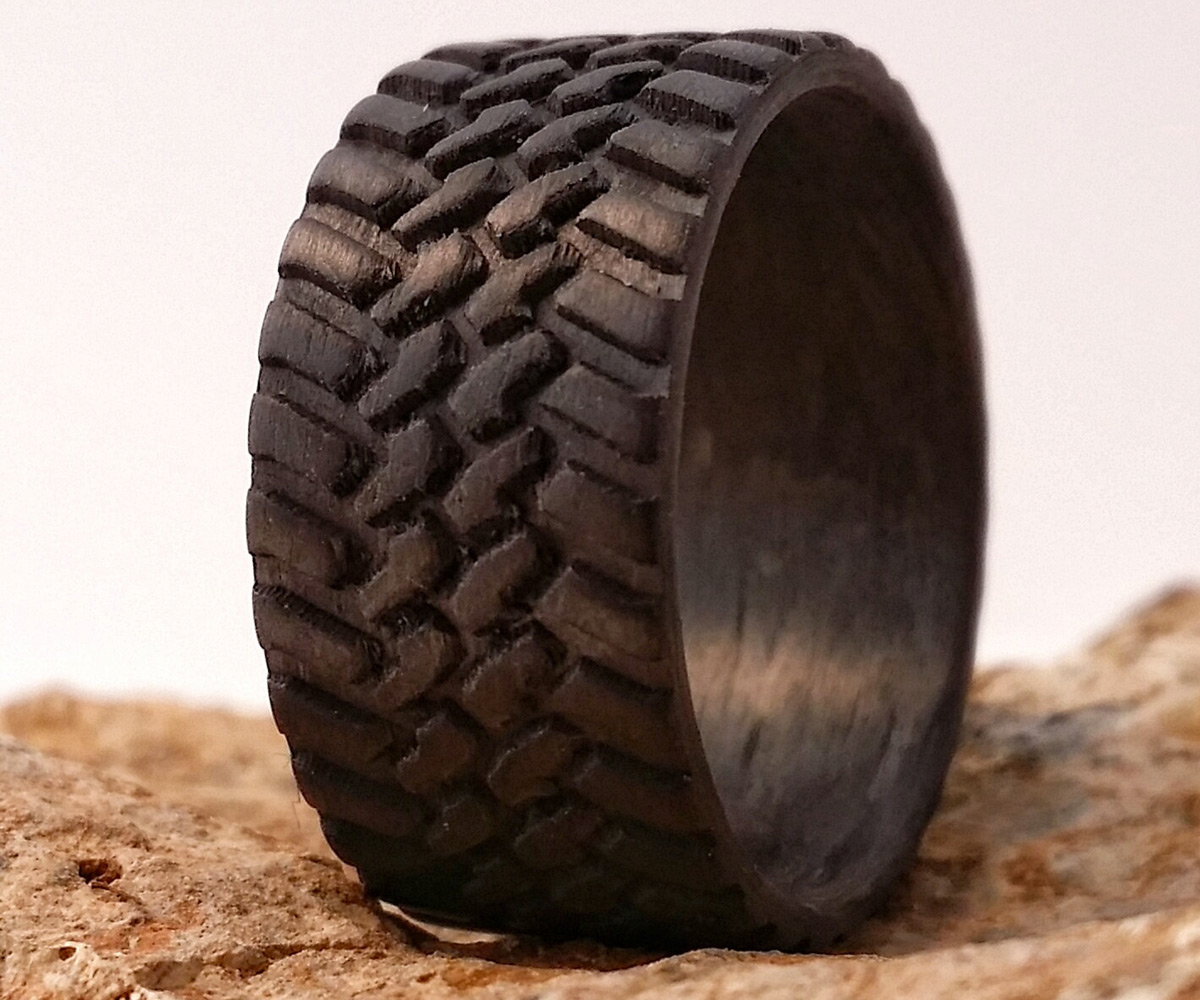 Tire Wedding Rings >> Carbon Fiber Tire Tread Rings | DudeIWantThat.com