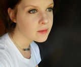 Girl Wearing Resident Evil T Virus Necklace