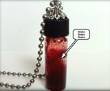 Vampire Hunter Trophy Fangs in Blood Vial
